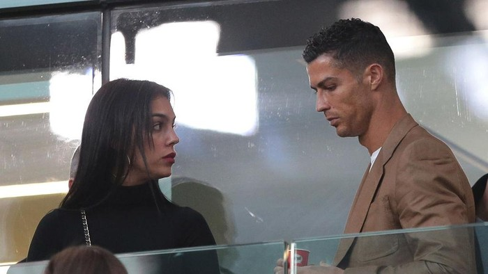 TURIN, ITALY - OCTOBER 02:  Cristiano Ronaldo and Georgina Rodriguez are seen during the Group H match of the UEFA Champions League between Juventus and BSC Young Boys at Allianz Stadium on October 2, 2018 in Turin, Italy.  (Photo by Emilio Andreoli/Getty Images)