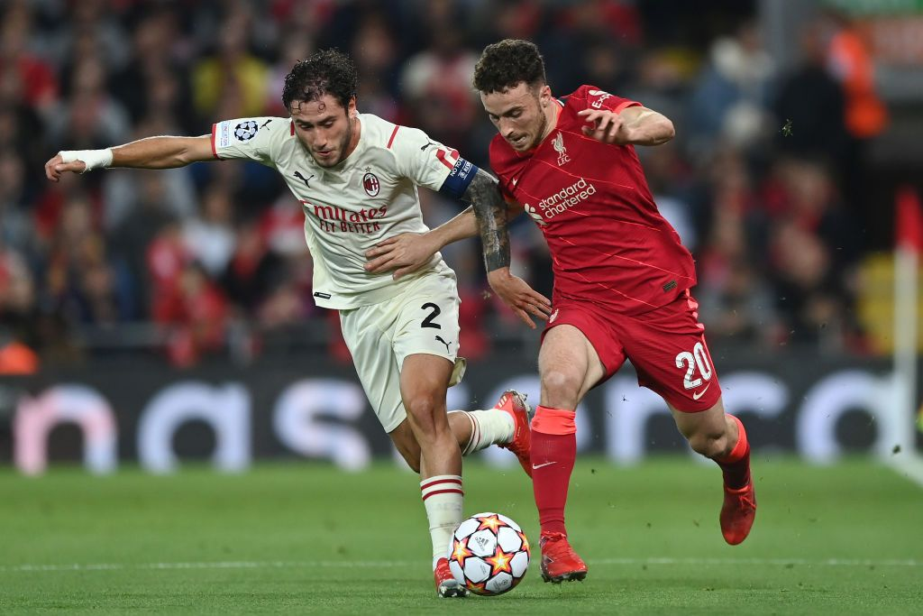 LIVERPOOL, ENGLAND - SEPTEMBER 15: Davide Calabria of AC Milan battles for possession with Diogo Jota of Liverpool during the UEFA Champions League group B match between Liverpool FC and AC Milan at Anfield on September 15, 2021 in Liverpool, England. (Photo by Shaun Botterill/Getty Images)