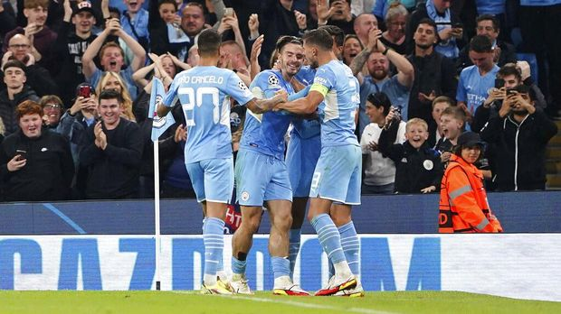 Manchester City's Jack Grealish, center, celebrates with teammates after scoring during the Champions League Group A soccer match between Manchester City and RB Leipzig at the Etihad Stadium, Manchester, England, Wednesday Sept. 15, 2021. (Zac Goodwin/PA via AP)