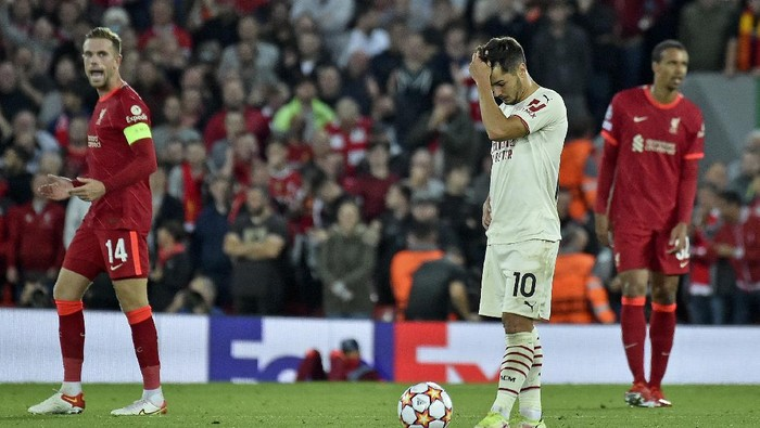 AC Milans Brahim Diaz reacts after Liverpools Jordan Henderson, left, celebrates scored his sides third goal during the Champions League Group B soccer match between Liverpool and AC Milan at Anfield, in Liverpool, England, Wednesday Sept. 15, 2021. (AP Photo/Rui Vieira)