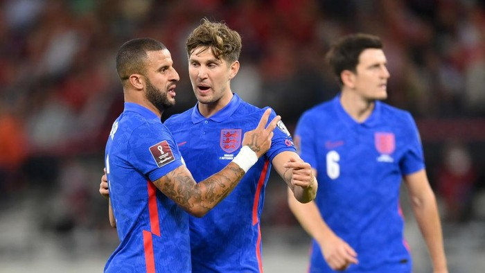 BUDAPEST, HUNGARY - SEPTEMBER 02: Kyle Walker and John Stones of England interact during the 2022 FIFA World Cup Qualifier match between Hungary and England at Stadium Puskas Ferenc on September 02, 2021 in Budapest, Hungary. (Photo by Michael Regan/Getty Images)