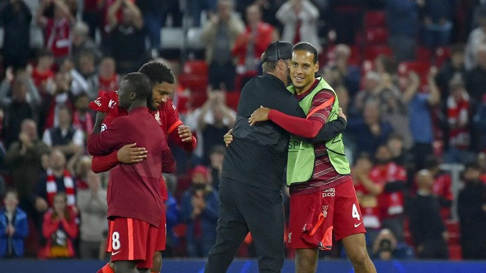 Liverpools Virgil van Dijk embraces Liverpools manager Jurgen Klopp at the end of the Champions League Group B soccer match between Liverpool and AC Milan at Anfield, in Liverpool, England, Wednesday Sept. 15, 2021. Liverpool won the match 3-2. (AP Photo/Rui Vieira)