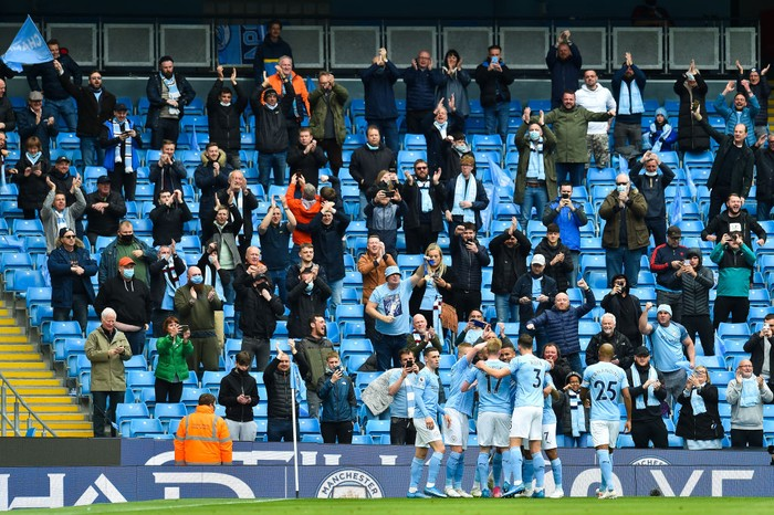 MANCHESTER, ENGLAND - MAY 23: Gabriel Jesus of Manchester City celebrates with teammates in front of their fans after scoring his teams second goal during the Premier League match between Manchester City and Everton at Etihad Stadium on May 23, 2021 in Manchester, England. A limited number of fans will be allowed into Premier League stadiums as Coronavirus restrictions begin to ease in the UK. (Photo by Peter Powell - Pool/Getty Images)