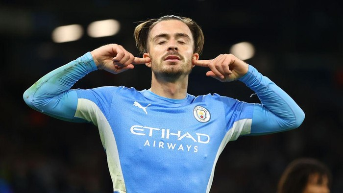 MANCHESTER, ENGLAND - SEPTEMBER 15: Jack Grealish of Manchester City celebrates after scoring their sides fourth goal during the UEFA Champions League group A match between Manchester City and RB Leipzig at Etihad Stadium on September 15, 2021 in Manchester, England. (Photo by Michael Steele/Getty Images)