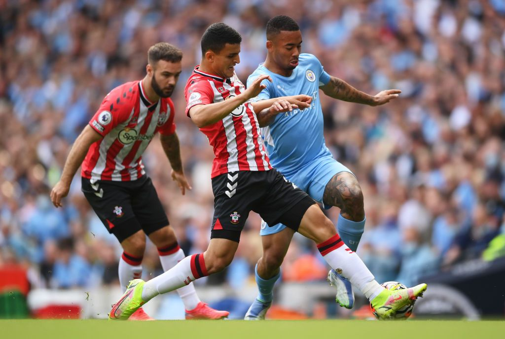 MANCHESTER, ENGLAND - SEPTEMBER 18: Gabriel Jesus of Manchester City is tackled by Mohamed Elyounoussi of Southampton during the Premier League match between Manchester City and Southampton at Etihad Stadium on September 18, 2021 in Manchester, England. (Photo by Laurence Griffiths/Getty Images)