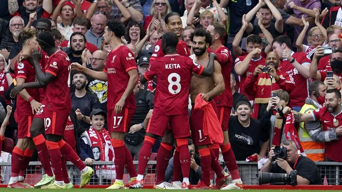 Liverpools Mohamed Salah, right, celebrates after scoring his sides second goal during the English Premier League soccer match between Liverpool and Crystal Palace at Anfield Stadium, Liverpool, England, Saturday Sep. 18, 2021. (AP Photo/Jon Super)