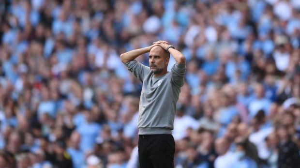 MANCHESTER, ENGLAND - SEPTEMBER 18: Pep Guardiola, Manager of Manchester City reacts during the Premier League match between Manchester City and Southampton at Etihad Stadium on September 18, 2021 in Manchester, England. (Photo by Laurence Griffiths/Getty Images)