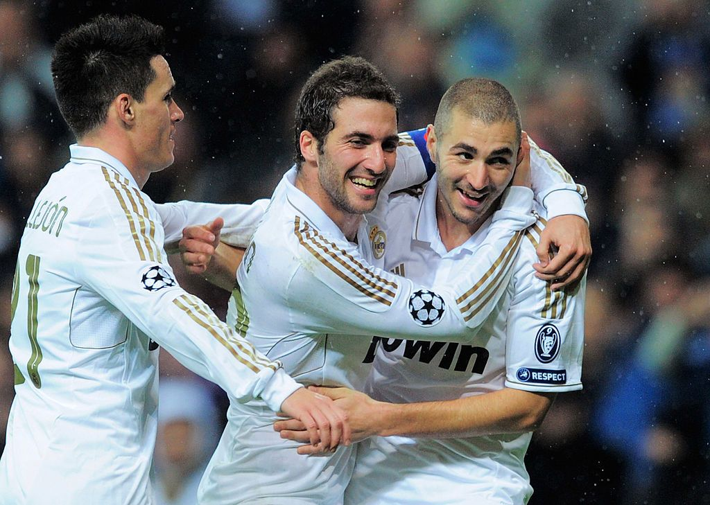 MADRID, SPAIN - APRIL 18:  Gonzalo Higuain of Real Madrid celebrates with Cristiano Ronaldo after scoring Real's first goal during the La Liga match between Real Madrid and Valencia at Estadio Santiago Bernabeu on April 18, 2010 in Madrid, Spain.  (Photo by Denis Doyle/Getty Images)