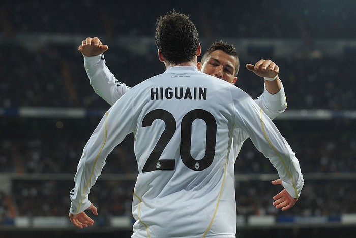 MADRID, SPAIN - APRIL 18:  Gonzalo Higuain of Real Madrid celebrates with Cristiano Ronaldo after scoring Reals first goal during the La Liga match between Real Madrid and Valencia at Estadio Santiago Bernabeu on April 18, 2010 in Madrid, Spain.  (Photo by Denis Doyle/Getty Images)