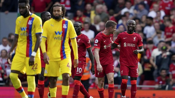 Liverpools Naby Keita, right, celebrates after scoring his sides third goal during the English Premier League soccer match between Liverpool and Crystal Palace at Anfield Stadium, Liverpool, England, Saturday Sep. 18, 2021. (AP Photo/Jon Super)