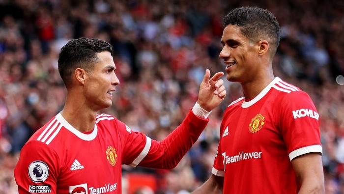 MANCHESTER, ENGLAND - SEPTEMBER 11: Cristiano Ronaldo of Manchester United with team mate Raphael Varane during the Premier League match between Manchester United and Newcastle United at Old Trafford on September 11, 2021 in Manchester, England. (Photo by Clive Brunskill/Getty Images)