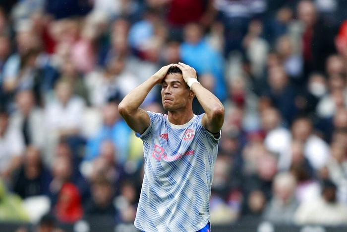 Manchester Uniteds Cristiano Ronaldo reacts after he failed to score a goal during the English Premier League soccer match between West Ham United and Manchester United at the London Stadium in London, England, Sunday, Sept. 19, 2021. (AP Photo/Ian Walton)