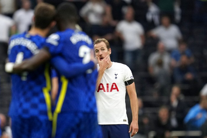 Tottenhams Harry Kane, center, reacts as Chelseas Antonio Rudiger, foreground with number 2, celebrates after scoring his sides third goal during the English Premier League soccer match between Tottenham Hotspur and Chelsea at the Tottenham Hotspur Stadium in London, England, Sunday, Sep. 19, 2021. (AP Photo/Matt Dunham)