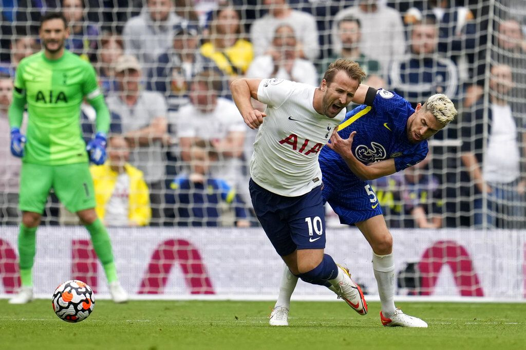 Tottenham's Harry Kane, center, reacts as Chelsea's Antonio Rudiger, foreground with number 2, celebrates after scoring his side's third goal during the English Premier League soccer match between Tottenham Hotspur and Chelsea at the Tottenham Hotspur Stadium in London, England, Sunday, Sep. 19, 2021. (AP Photo/Matt Dunham)