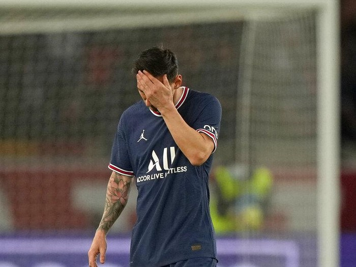 PSGs Lionel Messi reacts after Lyons Lucas Paqueta scored the opening goal during the French League One soccer match between Paris Saint-Germain and Lyon at the Parc des Princes in Paris Sunday, Sept. 19, 2021. (AP Photo/Francois Mori)