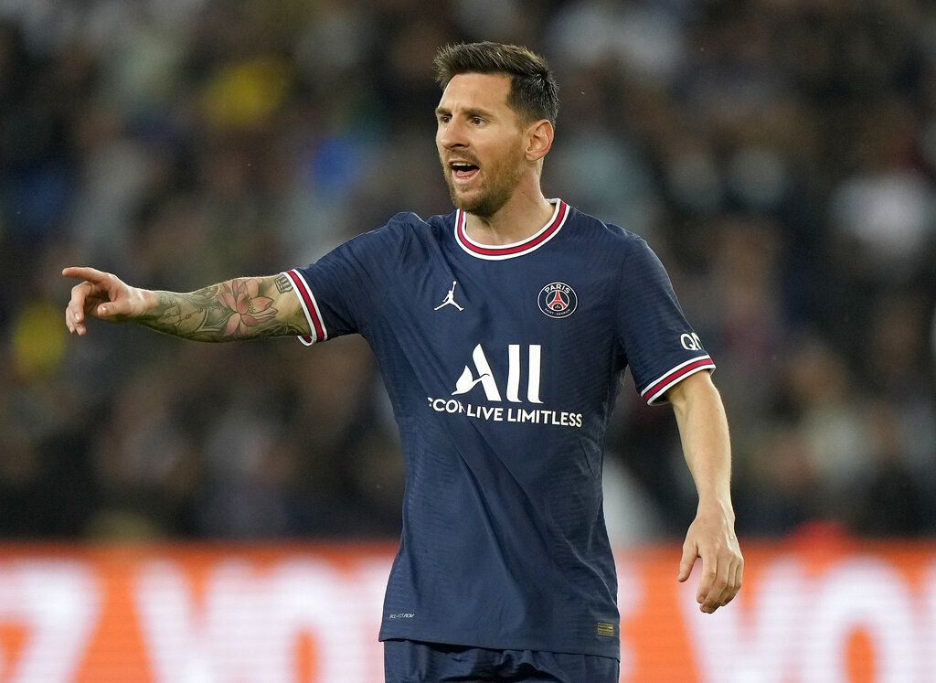 PSG's Lionel Messi reacts after Lyon's Lucas Paqueta scored the opening goal during the French League One soccer match between Paris Saint-Germain and Lyon at the Parc des Princes in Paris Sunday, Sept. 19, 2021. (AP Photo/Francois Mori)