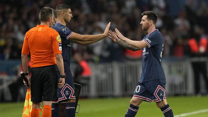 PSGs Lionel Messi looks down after he was substituted during the French League One soccer match between Paris Saint-Germain and Lyon at the Parc des Princes in Paris Sunday, Sept. 19, 2021. (AP Photo/Francois Mori)