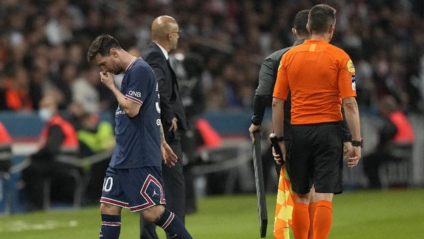 PSG's Lionel Messi looks down after he was substituted during the French League One soccer match between Paris Saint-Germain and Lyon at the Parc des Princes in Paris Sunday, Sept. 19, 2021. (AP Photo/Francois Mori)