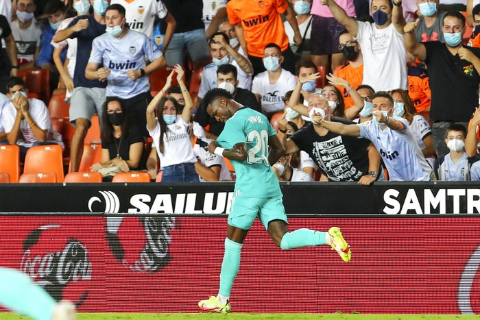Real Madrids Vinicius Junior celebrates after scoring his sides first goal during a Spanish La Liga soccer match between Valencia and Real Madrid at the Mestalla stadium in Valencia, Spain, Sunday, Sept. 19, 2021. (AP Photo/Alberto Saiz)