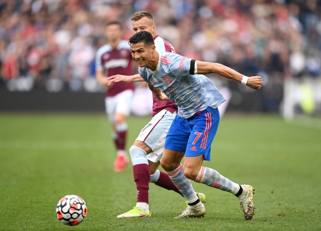 LONDON, ENGLAND - SEPTEMBER 19: Cristiano Ronaldo of Manchester United is challenged by Andriy Yarmolenko of West Ham United during the Premier League match between West Ham United and Manchester United at London Stadium on September 19, 2021 in London, England. (Photo by Justin Setterfield/Getty Images)