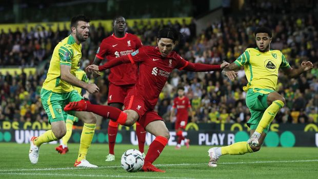 Soccer Football - Carabao Cup - Third Round - Norwich City v Liverpool - Carrow Road, Norwich, Britain - September 21, 2021 Liverpool's Takumi Minamino scores their first goal Action Images via Reuters/Paul Childs EDITORIAL USE ONLY. No use with unauthorized audio, video, data, fixture lists, club/league logos or 'live' services. Online in-match use limited to 75 images, no video emulation. No use in betting, games or single club /league/player publications.  Please contact your account representative for further details.