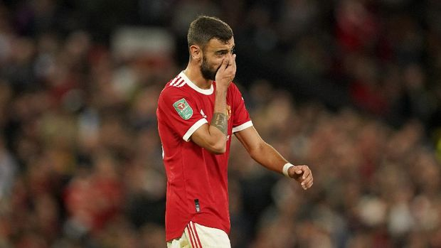 Manchester United's Bruno Fernandes touches his face during the English League Cup soccer match between Manchester United and West Ham at Old Trafford in Manchester, England, Wednesday, Sept. 22, 2021. (AP Photo/Dave Thompson)