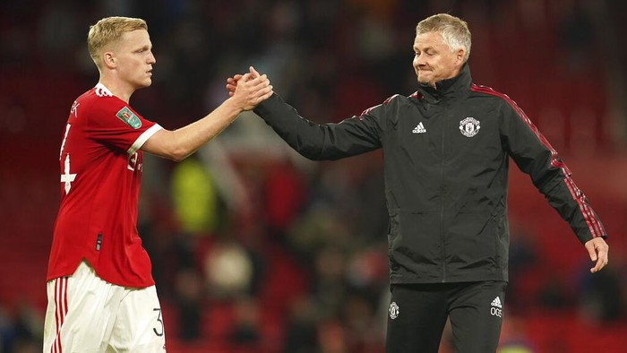 Manchester Uniteds manager Ole Gunnar Solskjaer greets Donny van der Beek at the end of the English League Cup soccer match between Manchester United and West Ham at Old Trafford in Manchester, England, Wednesday, Sept. 22, 2021. West Ham won the match 1-0. (AP Photo/Dave Thompson)