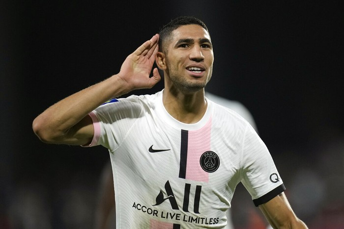PSGs Achraf Hakimi reacts after scoring his sides second goal during the French League One soccer match between FC Metz and Paris Saint-Germain at Saint Symphorien stadium, in Metz, eastern France, Wednesday, Sept. 22, 2021. (AP Photo/Christophe Ena)