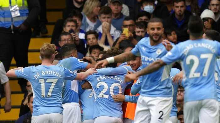 Manchester Citys Gabriel Jesus celebrates with teammates after scoring his sides opening goal during the English Premier League soccer match between Chelsea and Manchester City at Stamford Bridge Stadium in London, Saturday, Sept. 25, 2021. (AP Photo/Alastair Grant)