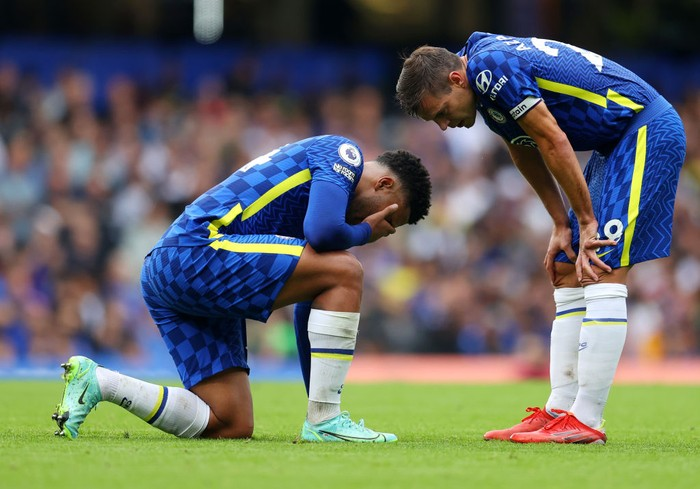 LONDON, ENGLAND - SEPTEMBER 25: Cesar Azpilicueta of Chelsea interacts with Reece James of Chelsea who is down injured  during the Premier League match between Chelsea and Manchester City at Stamford Bridge on September 25, 2021 in London, England. (Photo by Catherine Ivill/Getty Images)