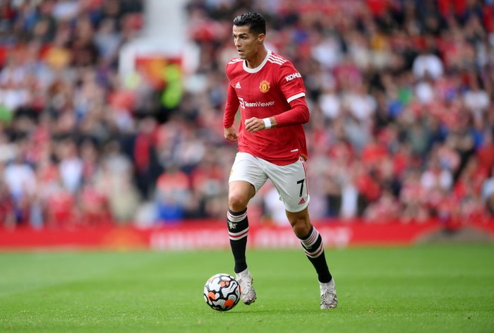 MANCHESTER, ENGLAND - SEPTEMBER 25: Cristiano Ronaldo of Manchester United makes a run with the ball during the Premier League match between Manchester United and Aston Villa at Old Trafford on September 25, 2021 in Manchester, England. (Photo by Laurence Griffiths/Getty Images)