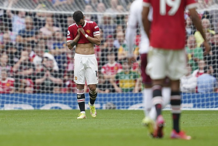 Manchester Uniteds Bruno Fernandes reacts after missing a penalty shot during the English Premier League soccer match between Manchester United and Aston Villa at the Old Trafford stadium in Manchester, England, Saturday, Sept 25, 2021. (AP Photo/Jon Super)
