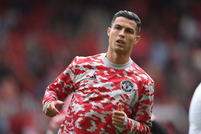 MANCHESTER, ENGLAND - SEPTEMBER 11: Cristiano Ronaldo of Manchester United warms up prior to the Premier League match between Manchester United and Newcastle United at Old Trafford on September 11, 2021 in Manchester, England. (Photo by Laurence Griffiths/Getty Images)