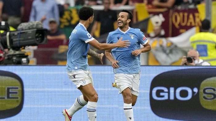 Lazios Pedro, right, celebrates after scoring his sides second goal during a Serie A soccer match between Lazio and Roma, at Romes Olympic Stadium, Sunday, Sept. 26, 2021. (AP Photo/Andrew Medichini)