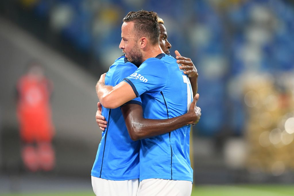 NAPLES, ITALY - SEPTEMBER 26: Amir Rrahmani and Victor Osimhen of SSC Napoli celebrate the 1-0 goal scored by Victor Osimhen during the Serie A match between SSC Napoli and Cagliari Calcio at Stadio Diego Armando Maradona on September 26, 2021 in Naples, Italy. (Photo by Francesco Pecoraro/Getty Images)