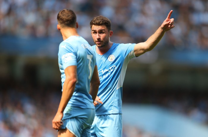 MANCHESTER, ENGLAND - AUGUST 28: Aymeric Laporte of Manchester City talks to Ruben Dias of Manchester City during the Premier League match between Manchester City  and  Arsenal at Etihad Stadium on August 28, 2021 in Manchester, England. (Photo by Catherine Ivill/Getty Images)