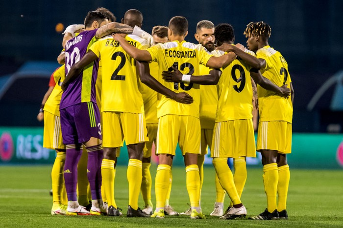 ZAGREB, CROATIA - AUGUST 25: Players of FC Sheriff embrace before the UEFA Champions League Play-Offs Leg Two match between Dinamo Zagreb and FC Sheriff at Maksimir Stadium on August 25, 2021 in Zagreb, Croatia. (Photo by Jurij Kodrun/Getty Images)