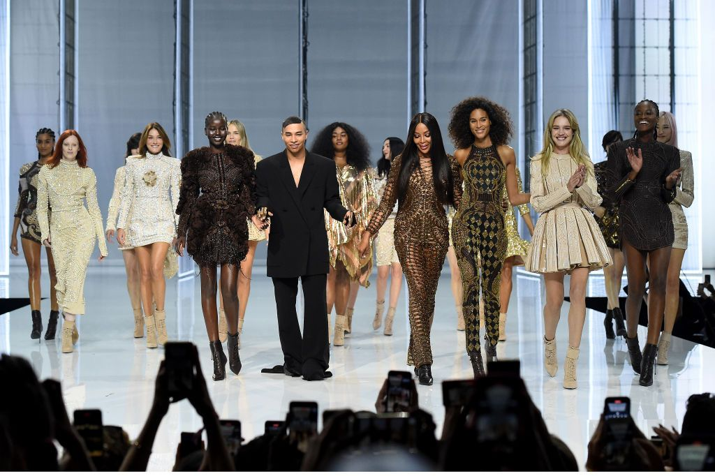 BOULOGNE-BILLANCOURT, FRANCE - SEPTEMBER 29: (EDITORIAL USE ONLY - For Non-Editorial use please seek approval from Fashion House)  Designer Olivier Rousteing and models walk the runway during the Balmain Festival V02 Womenswear Spring/Summer 2022 show as part of Paris Fashion Week at La Seine Musicale on September 29, 2021 in Boulogne-Billancourt, France. (Photo by Dominique Charriau/Getty Images )