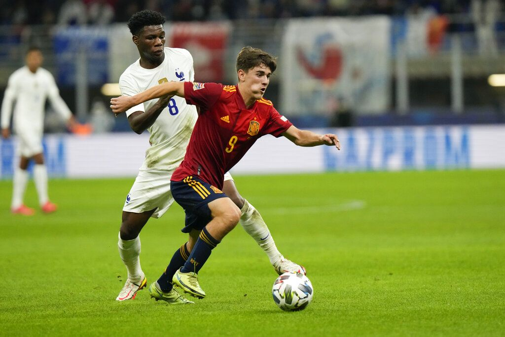 France's Aurelien Tchouameni, left, and Spain's Gavi vie for the ball during the UEFA Nations League final soccer match between France and Spain at the San Siro stadium, in Milan, Italy, Sunday, Oct. 10, 2021. (AP Photo/Luca Bruno)