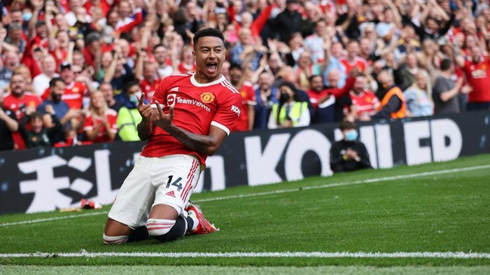 MANCHESTER, ENGLAND - SEPTEMBER 11: Jesse Lingard of Manchester United celebrates after scoring their sides fourth goal during the Premier League match between Manchester United and Newcastle United at Old Trafford on September 11, 2021 in Manchester, England. (Photo by Clive Brunskill/Getty Images)