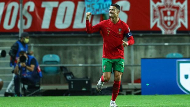 FARO, PORTUGAL - OCTOBER 12: Cristiano Ronaldo of Manchester United and Portugal celebrates scoring Portugal first goal during the 2022 FIFA World Cup Qualifier match between Portugal and Luxembourg at Estadio Algarve on October 12, 2021 in Faro, Faro. (Photo by Carlos Rodrigues/Getty Images)