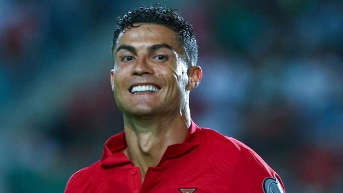 FARO, PORTUGAL - OCTOBER 12: Cristiano Ronaldo of Manchester United and Portugal celebrates scoring Portugals fifth goal and his third in the match during the 2022 FIFA World Cup Qualifier match between Portugal and Luxembourg at Estadio Algarve on October 12, 2021 in Faro, Faro. (Photo by Carlos Rodrigues/Getty Images)