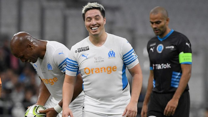 French former player Samir Nasri reacts during the charity