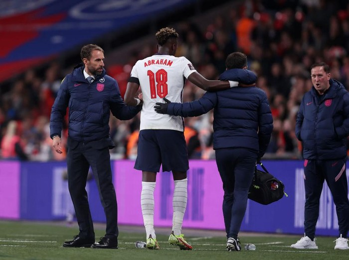 LONDON, ENGLAND - OCTOBER 12: Tammy Abraham of England leaves the pitch to receive medical attention during the 2022 FIFA World Cup Qualifier match between England and Hungary at Wembley Stadium on October 12, 2021 in London, England. (Photo by Julian Finney/Getty Images)