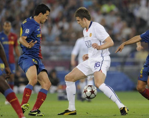Busquets dan Carrick (Getty Images)