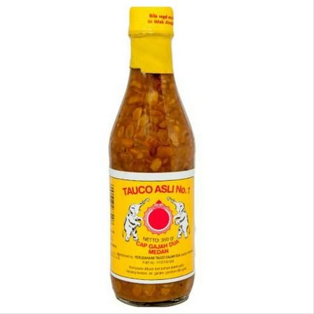 Tauco Cap Gajah 250gr. Tauco terbuat dari pasta kedelai yang berfungsi sebagai penyedap masakan alami. Umumnya, bumbu masakan ini digunakan dalam berbagai olahan masakan Jawa dan Sunda. Meski ada juga versi tauco lain yang berasal dari Kalimantan dan Suma