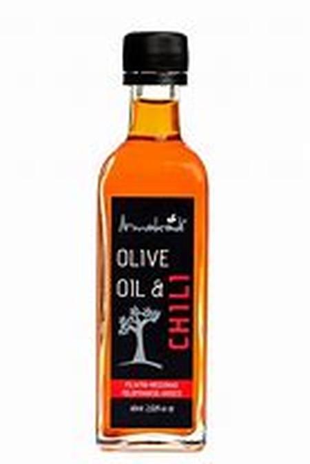 Toccofinale minyak extra virgin olive oil dengan ekstrak daun basil / kemangi dalam kemasan botol spray 60ml.