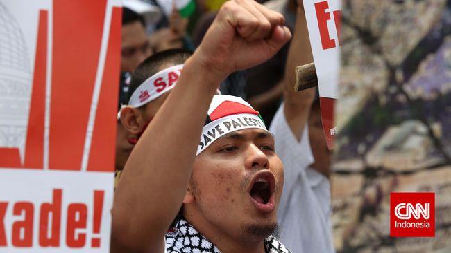 Massa buruh menggelar demo mendukung Palestina di Kantor Perwakilan PBB Jakarta, Selasa (18/5). Mereka mendesak Israel hengkang dari Yerusalem.