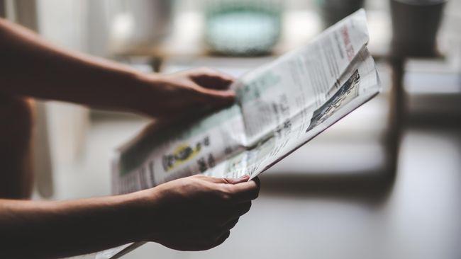 Ilustrasi membaca koran