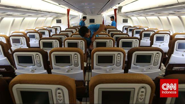 Maskapai penerbangan menerapkan jaga jarak antar penumpang untuk menekan risiko penyebaran virus corona.